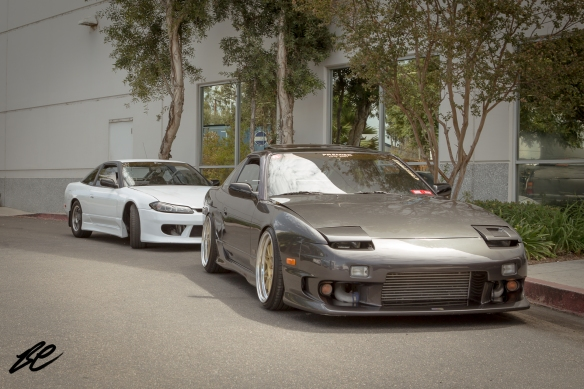 A neat looking S13 parked in front of another S13 with an S15 front end conversion.