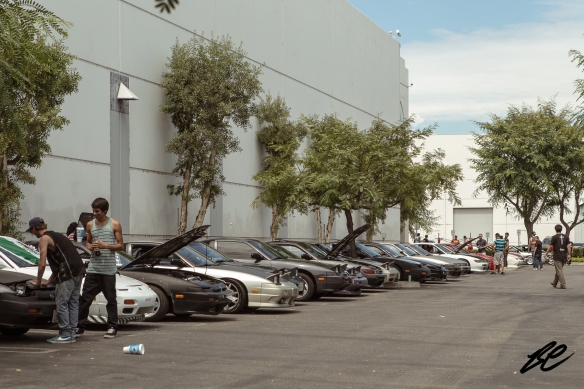 A row of early model Nissan 240sx coupes and hatchbacks.