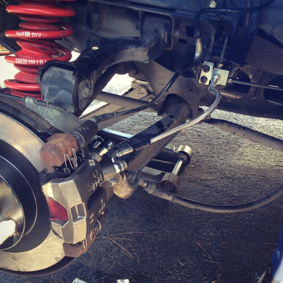 New caliper, new brake lines, and old caliper mount, ha.